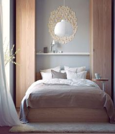 2012 IKEA Bedroom Design Inspiration for Small Space, tall thin wardrobes, shelf over the bed