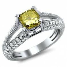 Cushion Cut Yellow Diamond Engagement Ring - Sparkling gemstones with the fanciest colored diamond you'll ever see come this stunning 18k White Gold Cushion Cut Yellow Diamond Engagement Ring in a Prong setting featuring a Yellow Cushion cut center stone with White Round Cut accent stones on the open shank. The Cushion Cut Yellow engagement ring comes with an SI1, VS1 & VS2 in clarity & E-F in color. The total weight is equal to 2.0 carats. The diamonds are 100% natural…