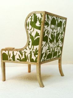 Ixelles Wing back chair with seat and back upholstered in white with green animals and plants by Casamidy