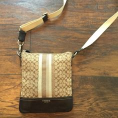 Coach Signature Crossbody Swingpack Brown/Tan with a little sparkle! One pocket on back as shown with top zip closure. Adjustable strap. Gently used-- some wear on the fabric. Cute little bag! Coach Bags Crossbody Bags