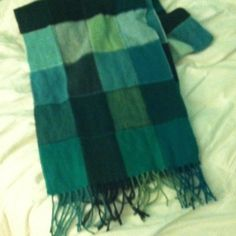 Plaid Cashmink Scarf Blue, turquoise, and black plaid super soft scarf, fringe on the ends. never been worn! Accessories Scarves & Wraps
