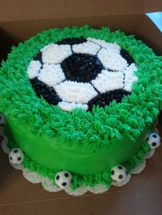 """Soccer Themed Cake Soccer theme 2 layer 10""""Vanilla cake with rasberry whipped cream filling iced in almond buttercream"""