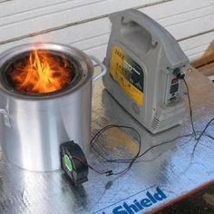 Large portable wood gasifier stove  Burn demo: http://www.youtube.com/watch?v=nWFF4AF0oXQ