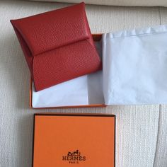 Hermes Bastia Coin purse Red Epsom Hermes Bastia coin purse in Red Epsom leather - Epsom is the most durable of the leathers, perfect for the coin purse.  Excellent used condition.  Comes with box, receipt copy. No trades, no low balls thanks! Hermes Bags Wallets