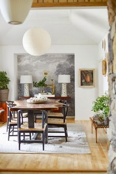 Every Piece in this photograph is Great: Mural, lamps, table, chairs, rug, lighting....etc.