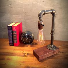 Industrial Lamp-Rustic Table Lamp-Steampunk Reading Desk Light-Pipe lamp-Vintage lamps-Classic Edison Bulb INCLUDED-Red Mahogany Wood Base    ADD ON: We offer a full range dimming socket to set just the right mood! The dimmer comes in silver and brass, this dimmer is available in our shop as an add on purchase!.  ***Choose Socket Color & Edison Bulb Style***  ITEM DETAILS -Measures 8W, 12H -Cord length 8F -Choose between silver or brass sockets (brass socket example can be viewed in pict...