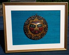 wooden tribal face mounted on turquoise raw silk and by PicToFrame, $18.00