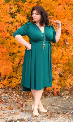 We are so green with envy....  @Hems for Her is looking GORGEOUS in this beautiful pic.  Here she is in the Winona Hi-Lo Wrap Dress by Kiyonna.  The colors in this pic just POP!  #Kiyonna #PlusSize #KiyonnaPlusYou