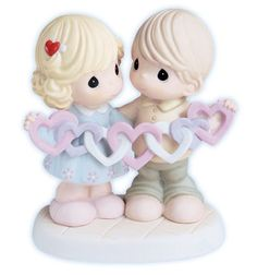 Precious Moments Figurine- Our Hearts Are Intertwined with Love $50.00