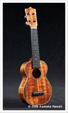 """STANDARD DELUXE (HF-1D) Also known as a Soprano Deluxe, this model has excellent tone. Deluxe features are rosewood binding, rope purfling, and a rope rosette around the sound hole. The fingerboard and bridge are ebony. *May request Spruce or Cedar top instead of Koa Overall length: 20-1/8"""" Scale length: 13-9/16"""" Total # frets: 16 Frets to the body: 12 MSRP: $1695"""