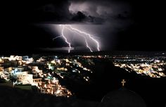 Lightning during a Thunderstorm on the island of Santorini Greece - Night storm with lightning bolts in Santorini, Greece. Filmed during the tour of the Mediterranean