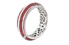 Madison Bangle from The Manhattan Collection: hand made 925 sterling silver plated with silver rhodium, hand-set with red sapphires and white topaz accented by white enamel.