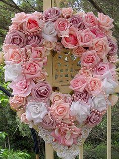 rose wreath  via Jamie Capps Kokoszka-  looks like diy chiffon roses with pink pearl garland, beautiful