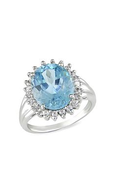 Silver Blue Topaz and White Topaz Ring - not a fan of the band but I like the halo