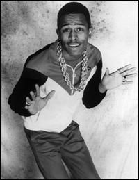 1986 | Queens native MC Shan and his superproducer cousin, Marley Marl, release the single 'The Bridge.' Though virtually unnoticed by the mainstream press, the song is an instant classic in hip-hop circles. Featuring steller 'new-school' production from Marl and clever lyrics in which Shan arrogantly announts his home, the Queensbridge Projects, hip-hop's new homebase; the song raised the ire of the newly-formed, South Bronx-based Boogie Down Productions. BDP's KRS-One disses Shan, Marl…