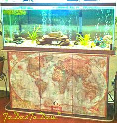 I repurposed maps before repurposing maps were cool. ;) I used a thrift store Nat Geo map decoupage, polyurethane, rope trim & paint to refurbish a rundown, pressboard aquarium stand I found for a steal.  My pics are horrible & truly do not do it justice. I am so proud of this. -T