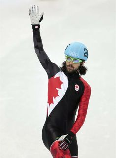 Charles Hamelin (Sainte-Julie, Quebec) of Canada waves to spectators after competing in a men's 1500m short track speedskating semifinal at the Iceberg Skating Palace during the 2014 Winter Olympics, Monday, Feb. 10, 2014, in Sochi, Russia. (AP Photo/Ivan Sekretarev)