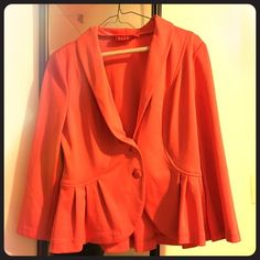 Gorgeous Coral Blazer W/ Amazing Detailing! Absolutely stunning coral blazer in excellent condition! This blazer has amazing detailing and is extremely flattering. The bottom of the blazer has some beautiful ruffle/bottom detailing and has an amazing cut making this jacket extremely flattering. The color is also beautiful on! Size medium Elle Jackets & Coats Blazers