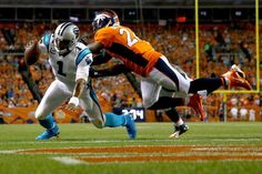 Quarterback Cam Newton #1 of the Carolina Panthers dives into the end zone to score on a two-yard run in the second quarter against free safety Darian Stewart #26 of the Denver Broncos at Sports Authority Field at Mile High on Sept. 8, 2016 in Denver.