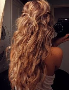 Who doesn't want perfect beach waves like these for summer? Wrap your hair around a large curling wand and spray in a texturizing spray to give hair a fresh off the beach look. Finish by twisting two front pieces and securing in the back.