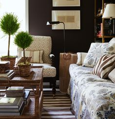 lovely living room with dark brown walls by Mark D Sikes. Love the mix of materials and colors - beautiful styling!