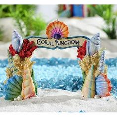 Fairy Garden Coral Arch. www.teeliesfairygarden.com . . . Let the fairies have a magical sea adventure when you add this awesome fairy garden coral arch today! Let lovely corals that made up this arch would make the fairies fall in love with the beauty of the sea! Have it in your garden today! #fairyarch