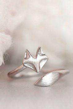 Twisting on silver hair. Silver fox ring