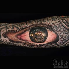 Today's tattoo of the day is this incredible piece by Cris Gherman. #InkedMagazine #eye #realism #tattoo #tattoos #art