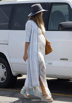 Jessica Alba is bohemian chic as she shows off her baby bump in tunic She's a tireless business mogul and a sought after actress. And Jessica Alba will add mother of three to her resume as she was seen showing off her baby bump on Saturday. Stylish Maternity, Maternity Wear, Maternity Fashion, Maternity Styles, Bump Style, Fashion Maman, Baby An Bord, Jessica Alba Style, Look Boho