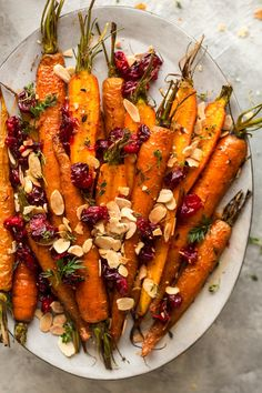 vegan-yums: Maple roasted carrots with cranberries / Recipe Omg. vegan-yums: Maple roasted carrots with cranberries / Recipe Omg this looks Vegetable Recipes, Vegetarian Recipes, Cooking Recipes, Healthy Recipes, Lentil Recipes, Simple Recipes, Pudding Recipes, Sausage Recipes, Quick Recipes
