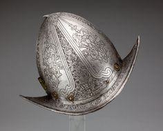 Northern Italian  Morion, c. 1580, with19th(?) century etching  Steel, brass, leather