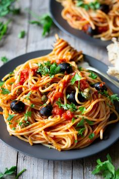Spaghetti with Puttanesa Sauce. A simple yet flavour packed Italian pasta dish. Made with store cupboard ingredients. Italian Recipes   Authentic Italian recipes   #insidetherustickiktchen #pasta #Italian #Italianfood #tomatoes