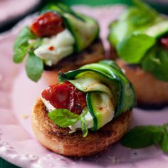 Zucchini rolls with dried tomatoes:  can't read the link, but using button mushrooms in place of the bread, this looks GREAT!!