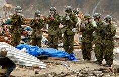 As more and more bodies were rescued, all crematoriums and morgues that weren't destroyed by the disaster were quickly filled. There was also soon a shortage of kerosene and dry ice as they are used in preservation. Here, members of Japan Self-Defense Force pray for the body of a tsunami victim in Onagawa on March 20, 2011.