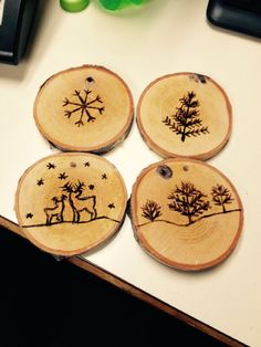 Wood burned snowflake trees and reindeer ornaments from birch branch slices.