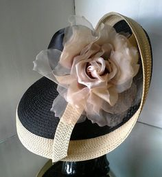 Harriet Rosebud Hats. Wonderful swoop to this strip straw hat finished with a giant silk rose. #judithm #sewnstraw