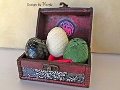 Dragon Eggs Game of Thrones Dragon Miniature by DesignByWendyBgd Dragon eggs - inspired by Game of Thrones. Rhaegal, Viserion and Drogon are waiting to be adopted by a Mother of Dragons or a Father of Dragons. DRACARYS! This cute miniature dragon eggs set includes 3 miniature eggs in a wooden chest, with Targaryen sigil inside the chest.   CAUTION: If you put the eggs on fire, you do that at your own risk! Either they will burn, or hatch dragons. ;)