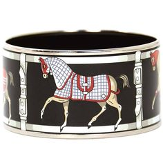 HERMES Black Enamel Horse Print Extra Wide Bangle Bracelet RT $725 | From a unique collection of vintage bangles at https://www.1stdibs.com/jewelry/bracelets/bangles/