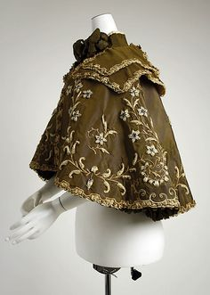 Opera cape (side view) Beer (French) Designer: Gustave Beer (French) Date: ca. 1896 Culture: French Medium: silk, wool Dimensions: Length at CB: 19 in. (48.3 cm) Credit Line: Gift of Everett S. Lee, 1980 Accession Number: 1980.588.1