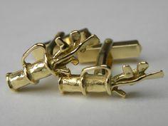 """manchetteknopen gemaakt van oud goud """"tas met golfclubs"""""""