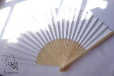 White paper fan for wedding guests