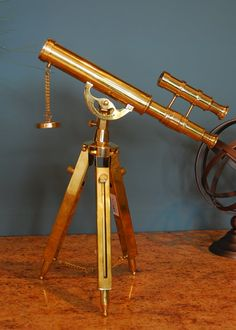 Vintage telescope set up at reception #thebridalcollection