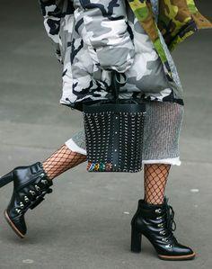 Shop now. Caroline Daur wearing Vetements jacket, Jil Sander sweater and Paco Rabanne bag between the fashion shows.