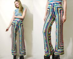 "// RESERVED for Tabitha //  ☩ RAINBOW CROCHET FLARES Handmade by Crux and Crow Constructed from a 70s vintage wool blanket Colourful rainbow crochet Slim fit upper with flared legs High waist with stretchy elastic waistband  Label: Crux & Crow Size on tag: - Best fit: XS-S Fabric: Wool Crochet Condition: Excellent, handmade  ☩ M E A S U R E M E N T S Length: 105cm (41"") Inner leg length: 82cm (32) Waist: 33-44cm (13-17"") Hips: 44cm (17"")  Measurements taken with garmen..."