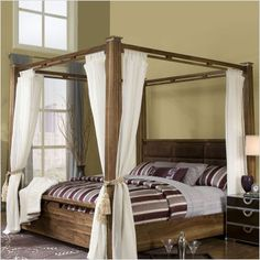 One day when we have a large master bedroom, I want a four poster bed!  AICO Exiterra Poster Bed in Timber.