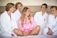 Photo by Michelle Lawson Photography. My bridesmaids/sisters and maid of honor. Dressed in robes on the bed, taking some cute getting ready pictures! #wedding #weddingideas #gettingdressed #weddingdress #behindthescenes #bridesmaids #mstriciasfl #gettingready #robes