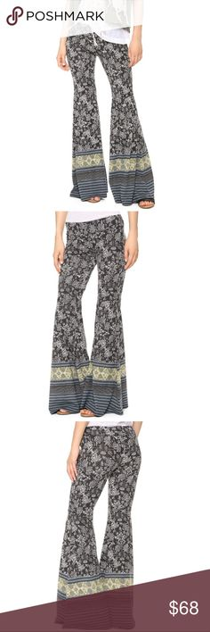 """Free People Festival Print Pull On Flare Pants xs Free People Festival Print Pull On Flare / Bell Bottom Pants. Soft jersey pants have a free-spirited boho feel with a dramatic, flared silhouette and a mix of lively patterns. The elastic waist gains flattering structure from a seamed yoke. Rare, hard to find color and style. Retail $128. Amazingly comfortable! Size XS but can fit a range of sizes as they are stretchy. Inseam 33""""+ (maybe a little longer because it depends how I measure since…"""