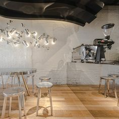 Celebrating coffee's intangible pleasures, Alberto Caiola translates coffee's aromatic vapors into a sculptural ceiling that is the centrepiece for this café...