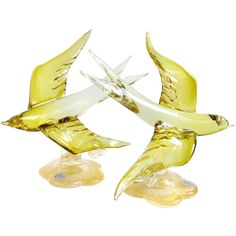 Murano Olive Yellow Gold Flecks Italian Art Glass Flying Swallow Bird Sculptures | From a unique collection of antique and modern sculptures at https://www.1stdibs.com/furniture/decorative-objects/sculptures/