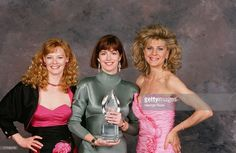 The stars of TV's 'China Beach,' (left) Marg Helgenberger, Dana Delany and Concetta Tomei, pose with the People's Choice Award at the 1989 Beverly Hills, California, backstage telecast photo shoot.